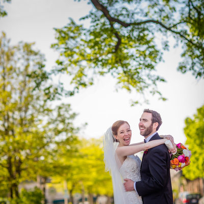 Laughing wedding couple in downtown Lake Forrest