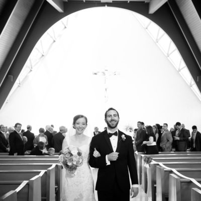 Smiling couple just married exits church