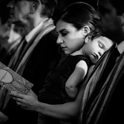 Sleeping baby girl at wedding ceremony