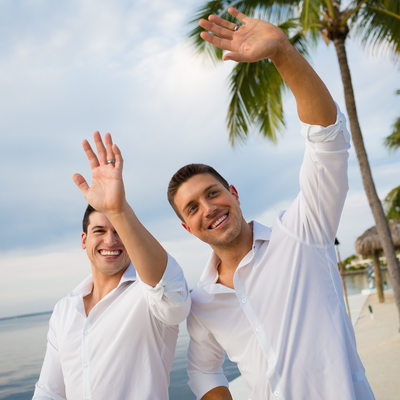 couple waving on florida beach