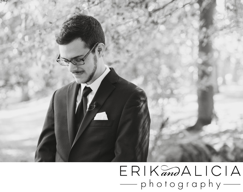 b&w groom awaiting his bride at cannon park