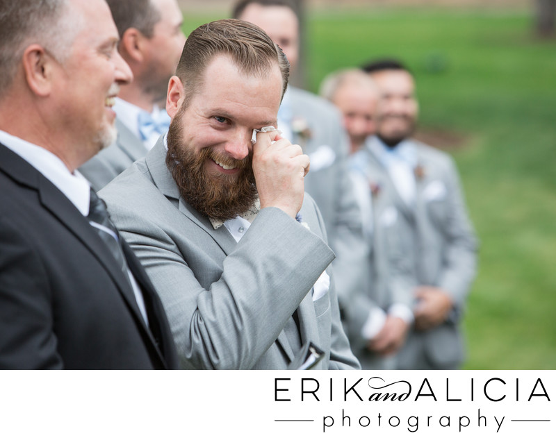 outdoor wedding groom crying at alter area
