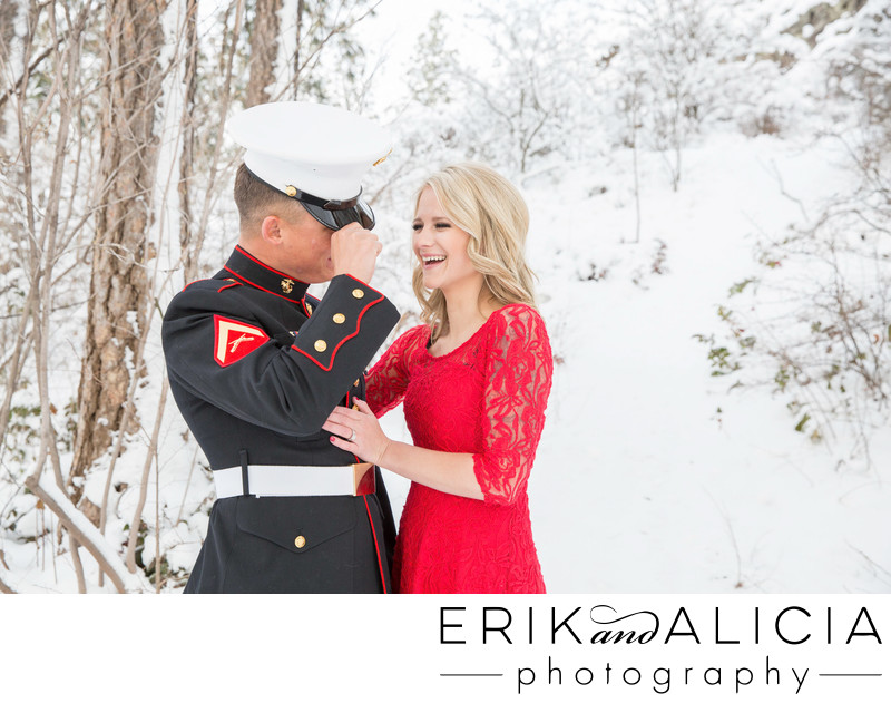 Marine dress blues with red dress in snowy engagement