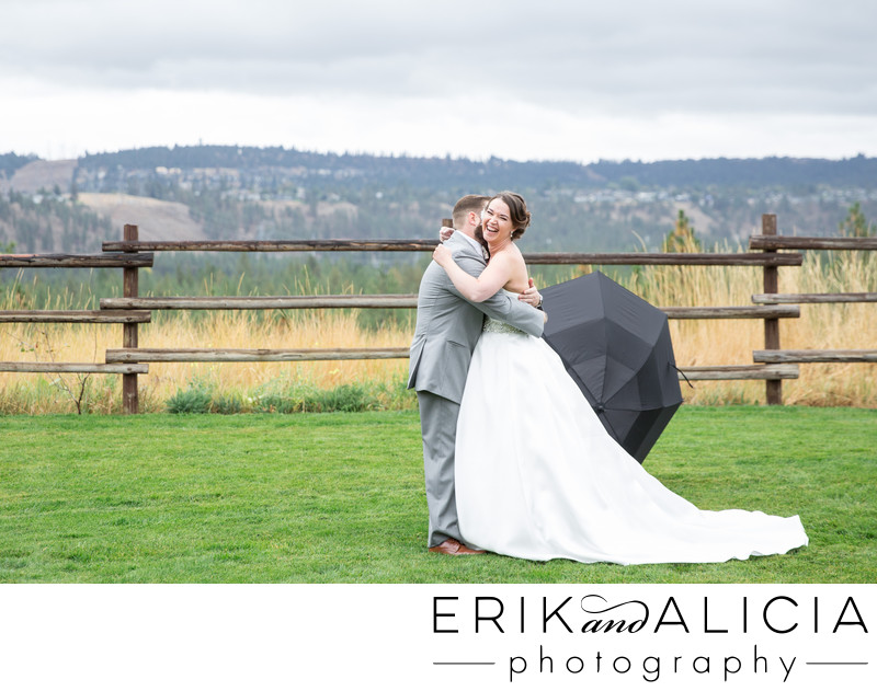 beautiful rainy wedding day first look with umbrella
