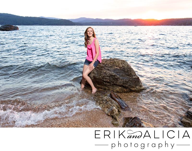 senior photo sunset on lake coeur dalene shoreline
