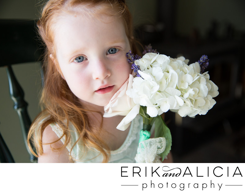 cute red head flower girl with bouquet