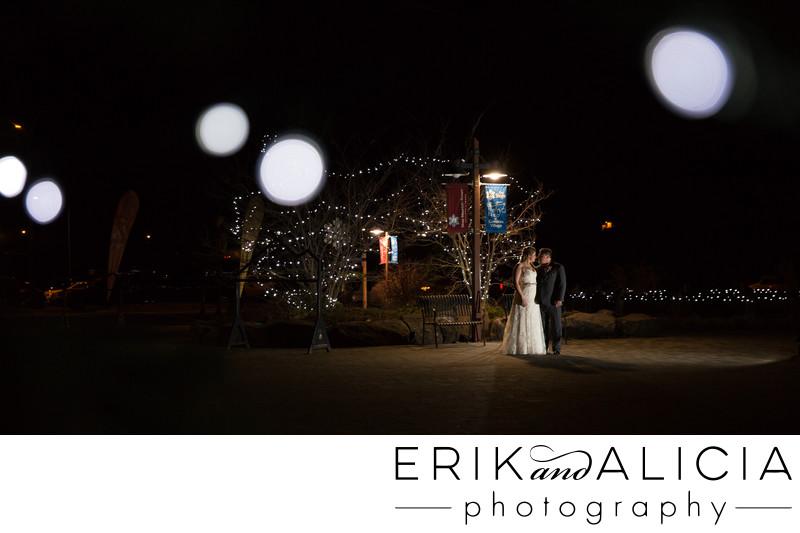 Winter wedding night photo under street lamp
