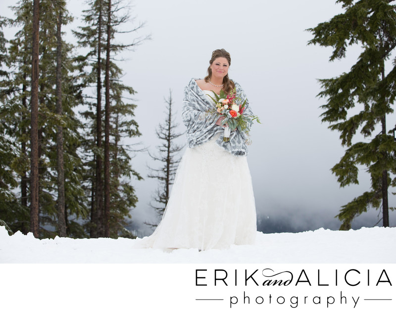 Bride on Silver Mountain peak wearing shawl