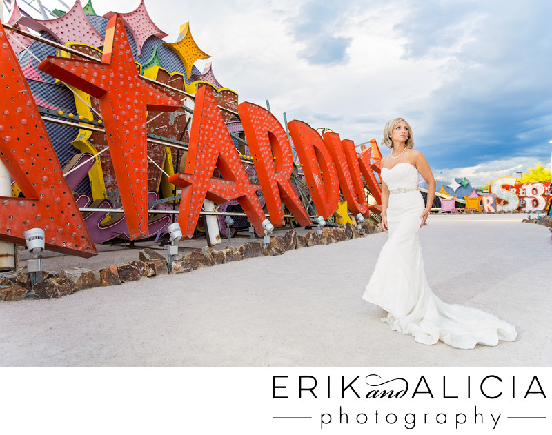 Neon Museum stormy las vegas sky full with bride