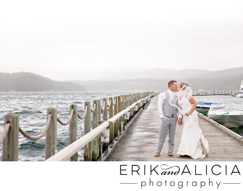 Coeur d'Alene lake dock windy wedding day kiss