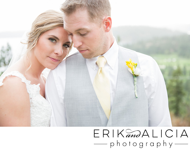 blue eyed bride with groom in gray vest