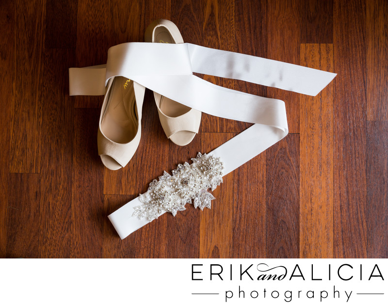 Wedding shoes with beaded details on wood floor
