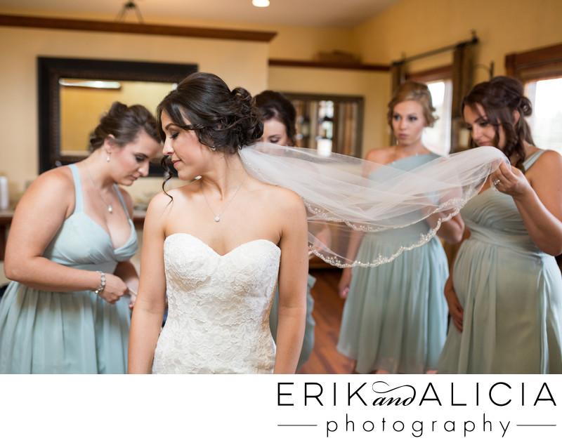 Lacing up wedding dress at Beacon Hill Spokane
