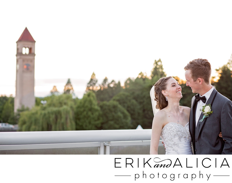 Spokane clock tower at sunset with bride and groom