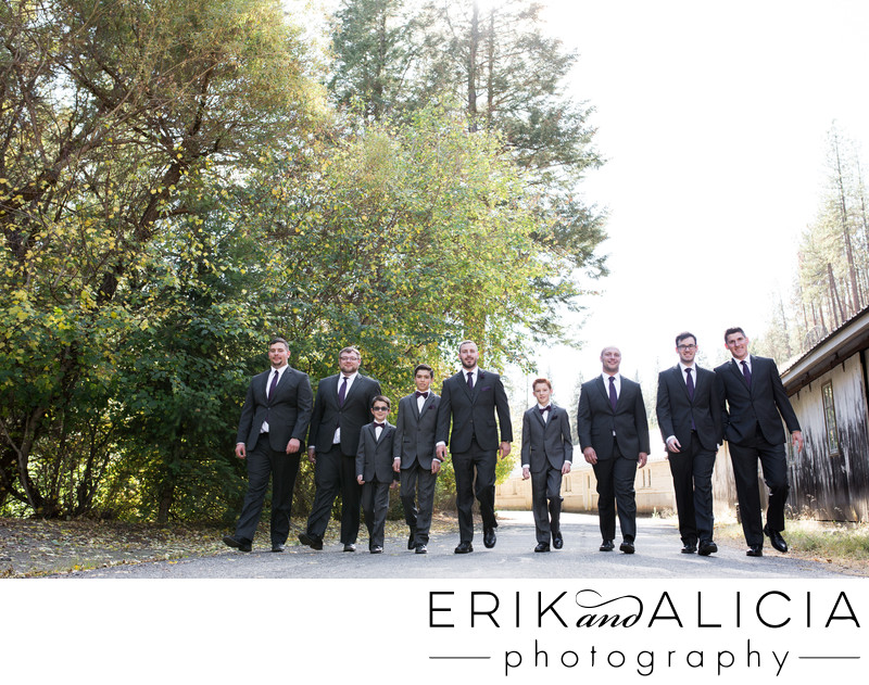Road walk by groom and his men at Commellini