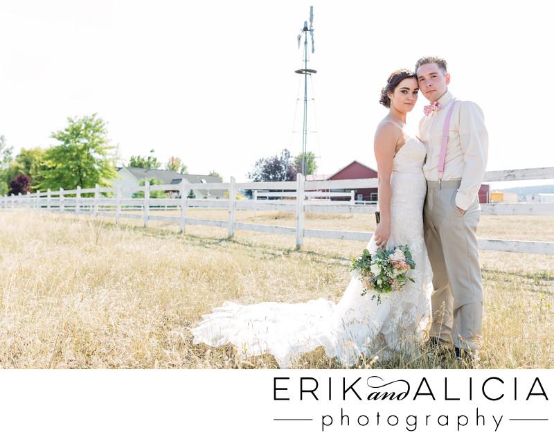 beautiful couple portrait in field with windmill