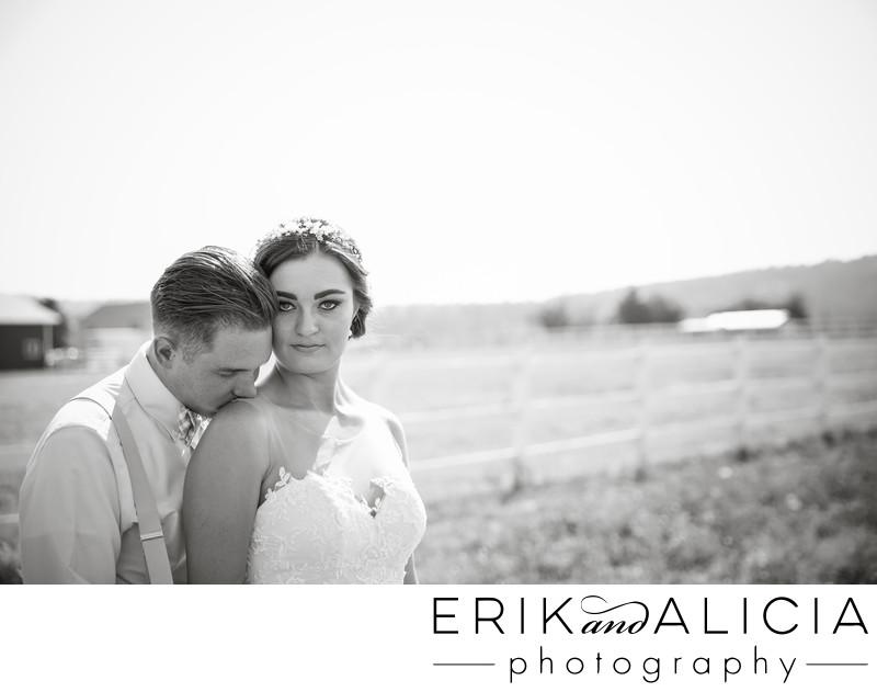 shoulder kiss in b&w intense bride eyes
