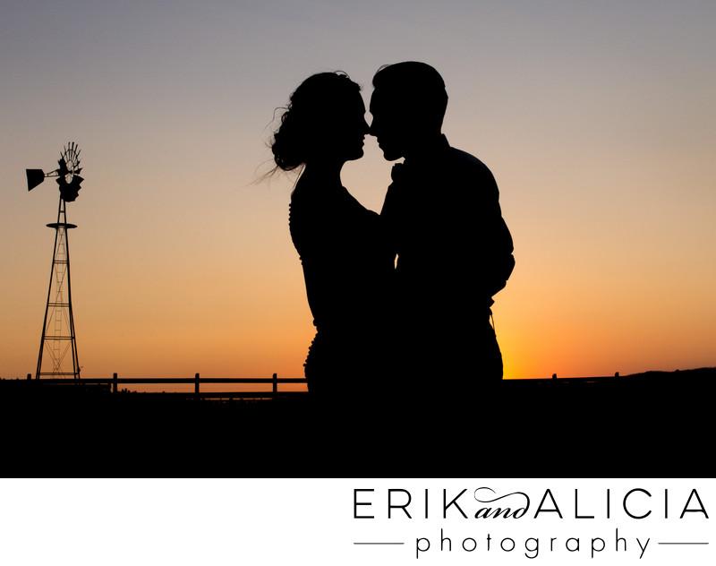 stunning silhouette kiss near windmill