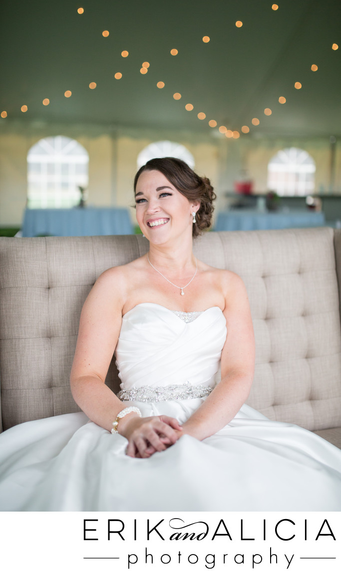 pearl bracelet worn by bride with beaming smile