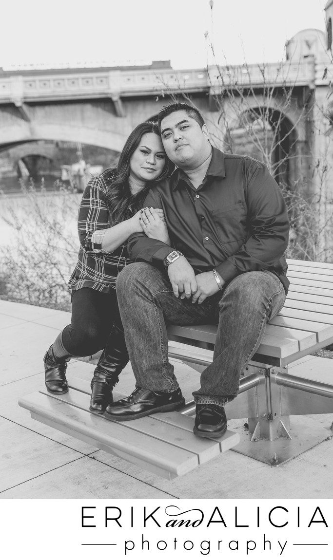 engagement photo sitting on picnic table Kendal Yards