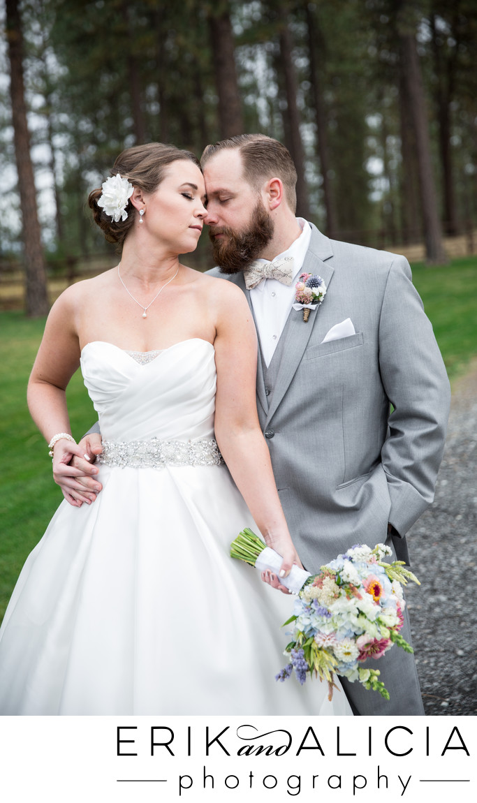 groom in gray suit romantic embrace with his bride