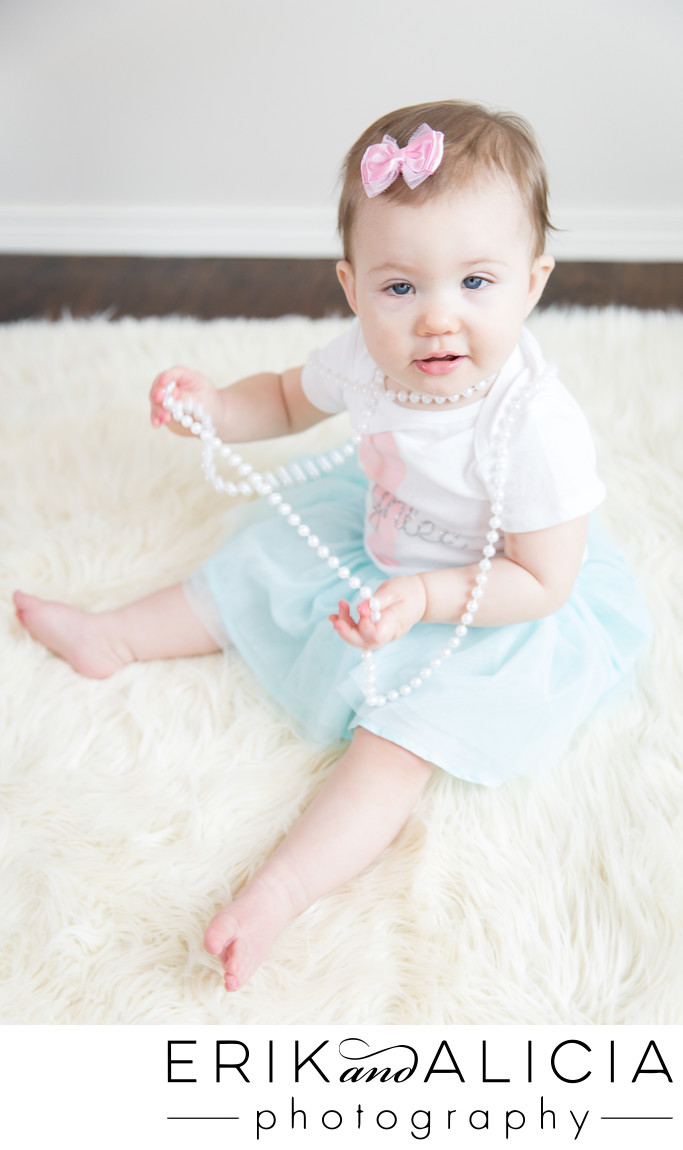 girl turns one blue tutu pearls and a pink bow