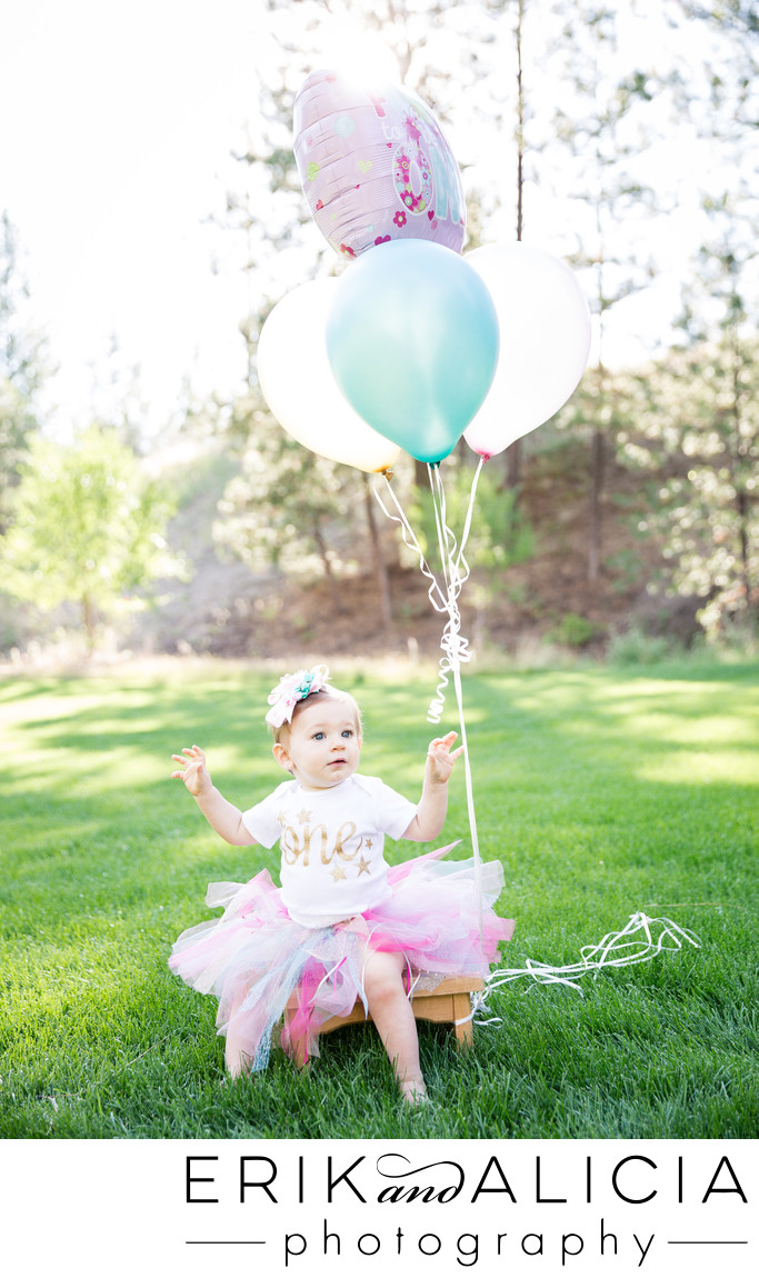 spring baby girl turns one with fun balloons