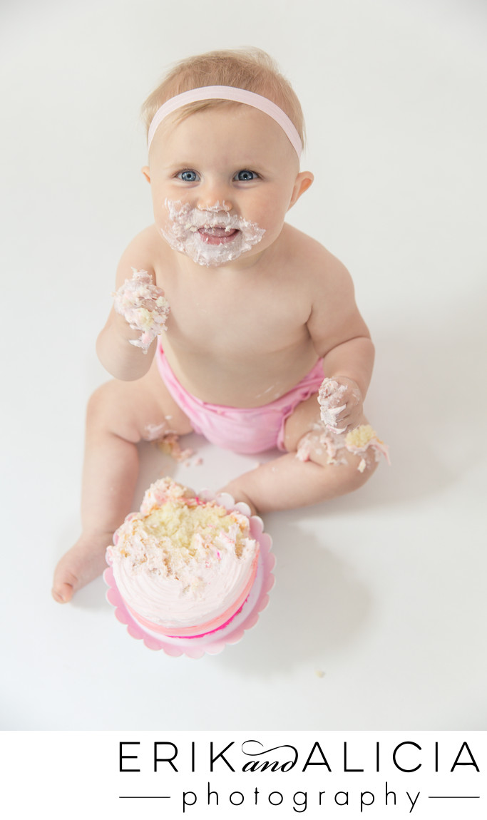 baby girl loves pink cake smash