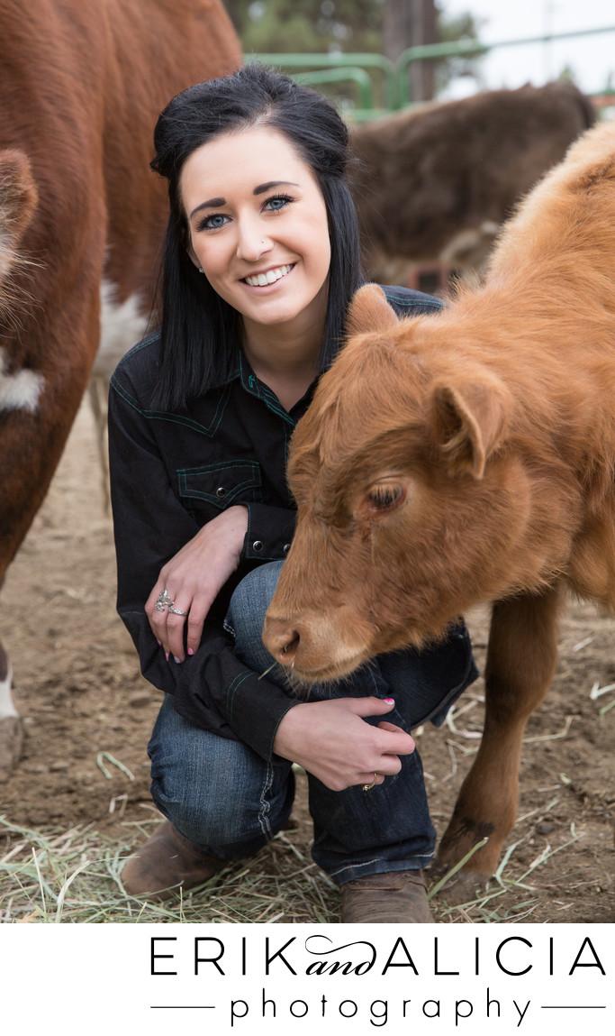 farm girl senior portrait with calf