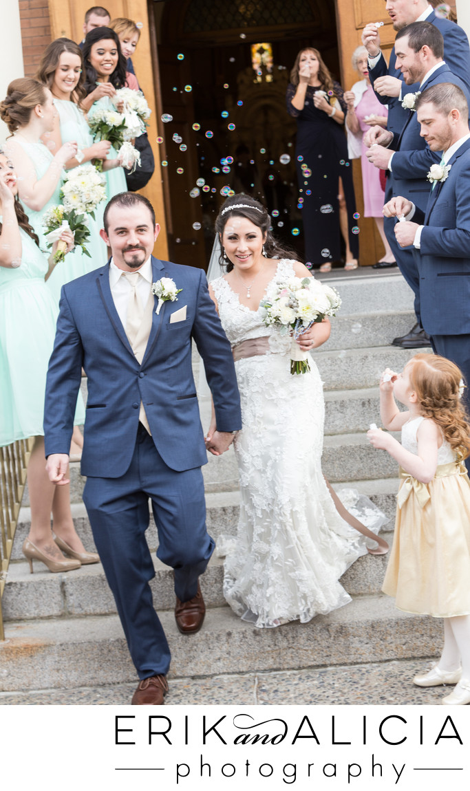 newlyweds-walk-through-bubbles