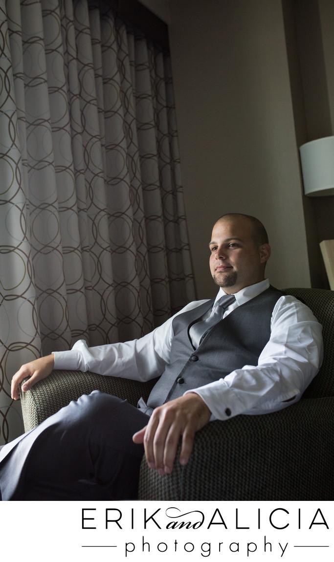 Masculine window light groom wedding day portrait