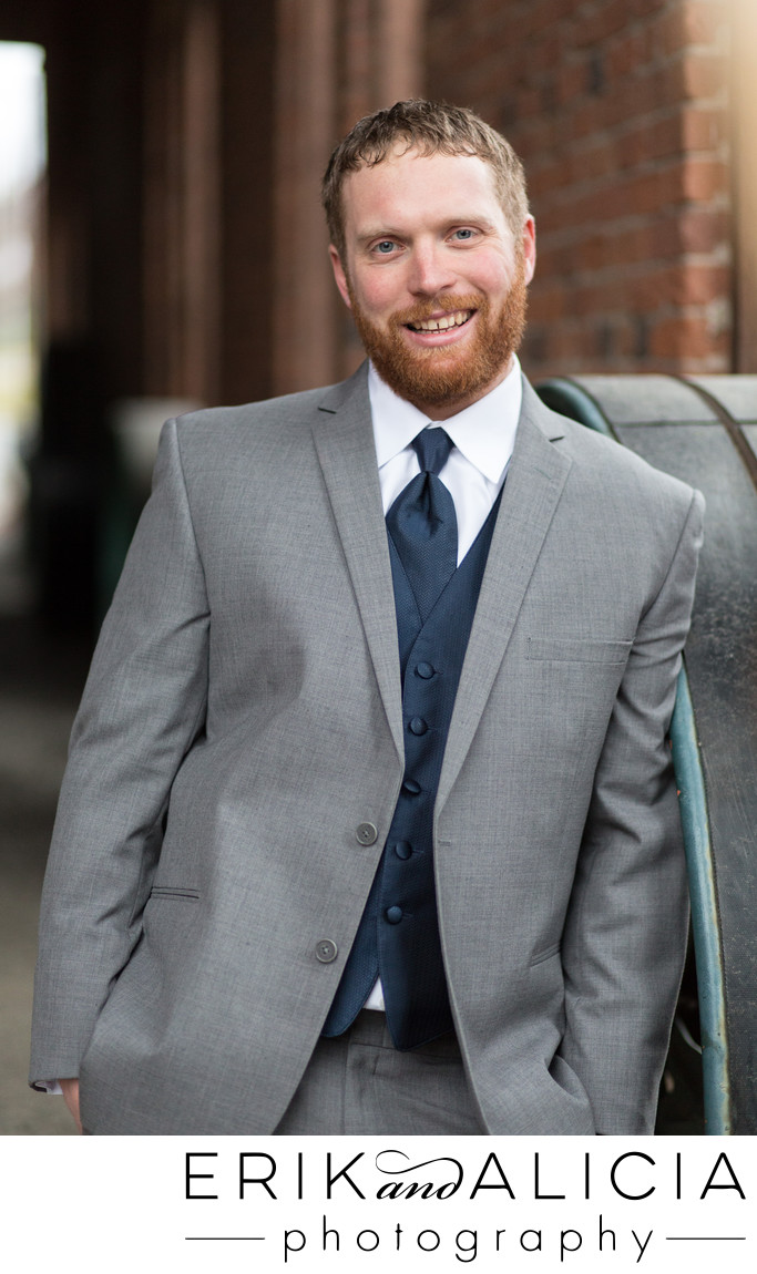 Red head groom with beard gray suit and blue vest & tie