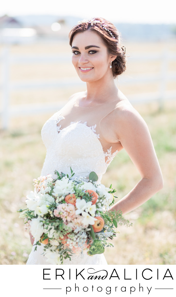 Orange pink and white flowers in bridal bouquet