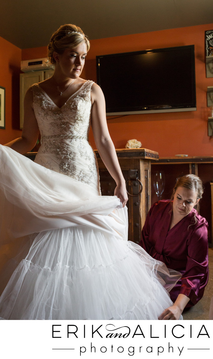 wedding dress primping by maid of honor