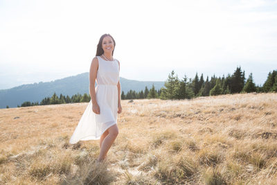bride to be on a mountain top