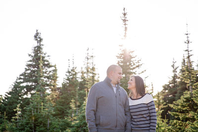 fall engagement sweaters in the forest