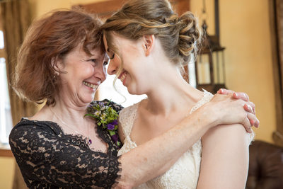 mother of the bride embrace