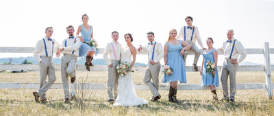 Bridal party on white picket fence