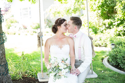 kissing on rope swing during wedding day