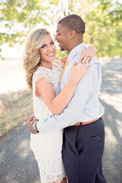 amazing couple embrace fiancé in white dress