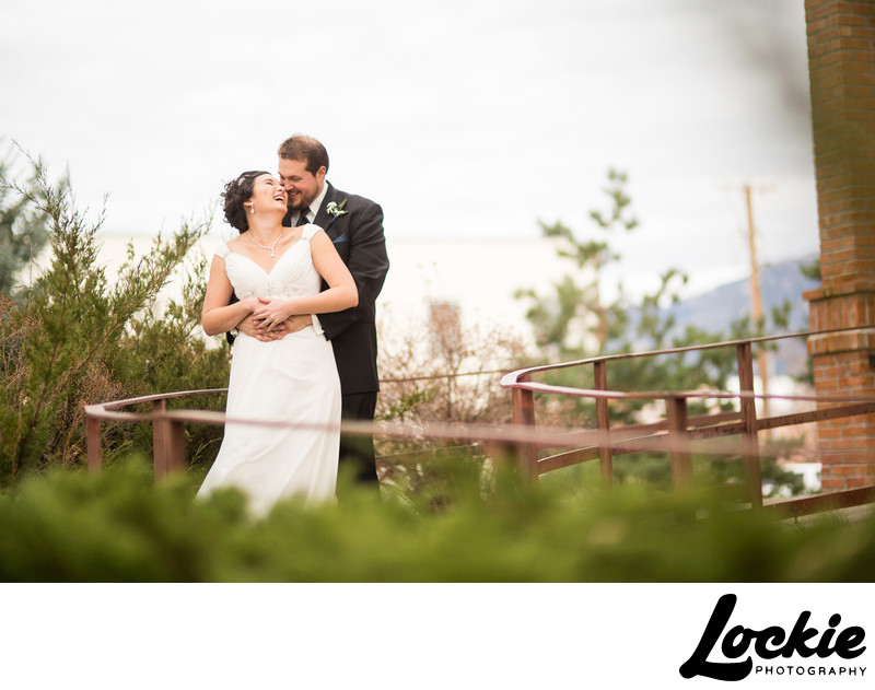 Bride and groom laughing wedding photos in Montana
