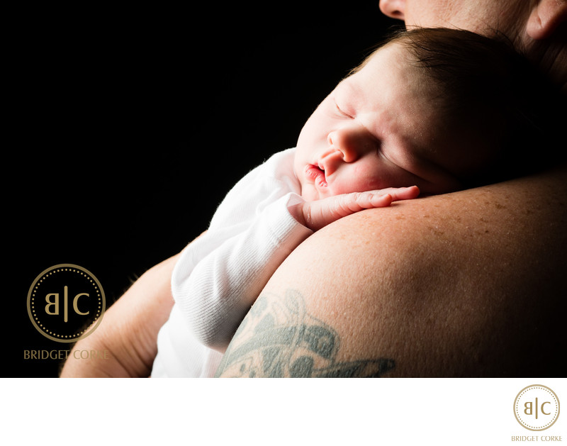 Newborn Photographed on Shoulder of Dad in Studio