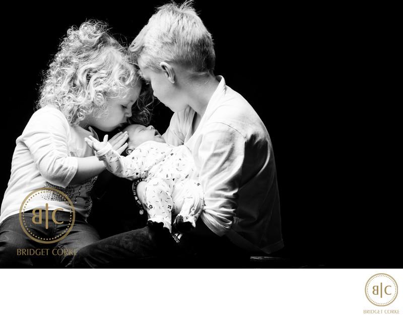 Siblings Moment with Newborn in Studio Shoot