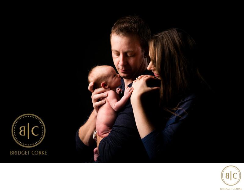 Parents with Newborn Photographed In Studio
