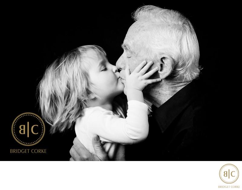 Grandpa Getting a Big Kiss