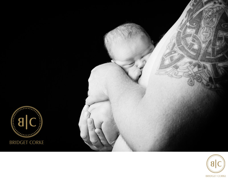 Tatooed Father and Newborn Captured in Studio