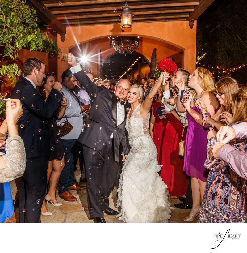 Houston wedding Photographer grand exits with bubbles