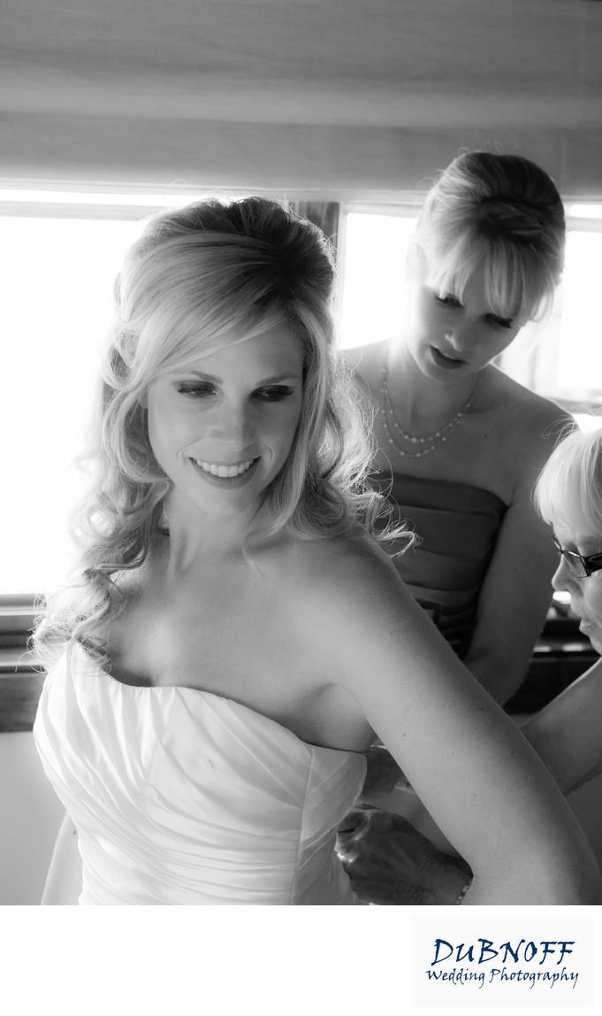 zipping wedding dress