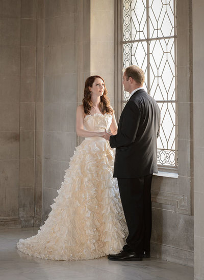 bride and groom window light