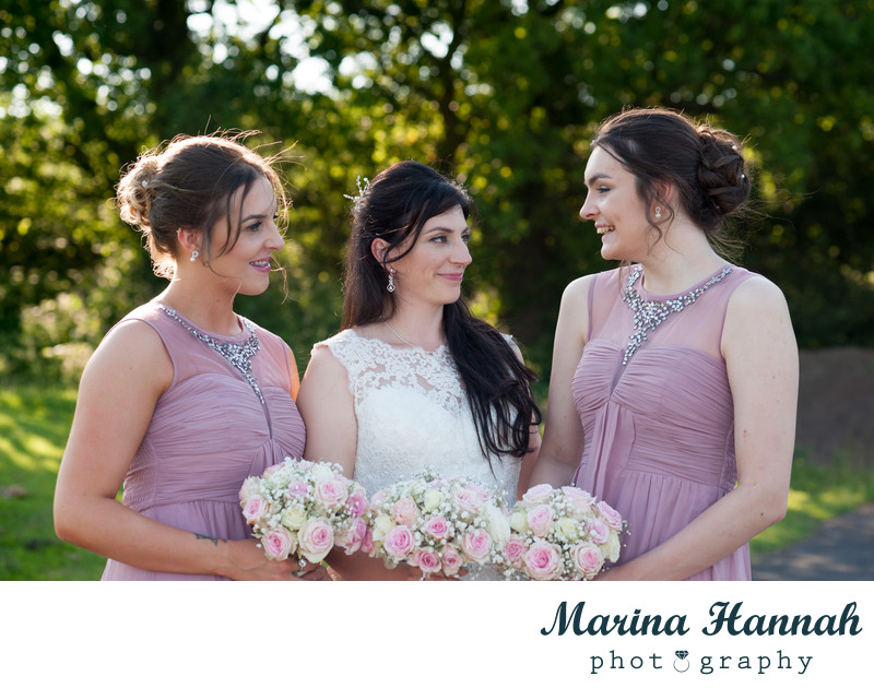 Bride and her bridesmaids at a beautiful summer wedding